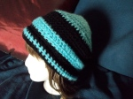 Black satin-soft and turquoise fuzzy cloche style fold over tuque